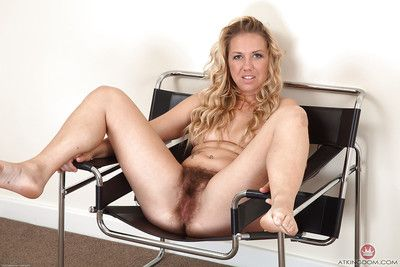 Chunky mature lady Elle Macqueen freeing really hairy cunt from white panties