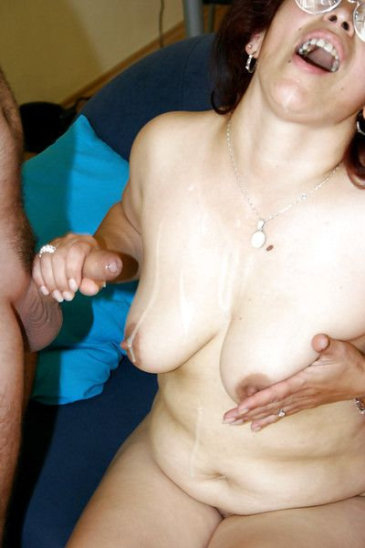 Lecherous granny in glasses gets shagged for jizz on her big saggy jugs