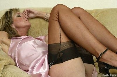 Sexy mature Satin Jayde shows off hot ass wearing lace panties and stockings