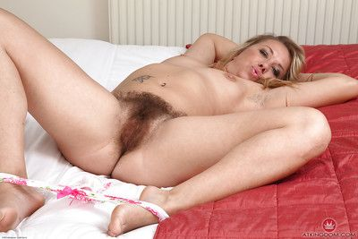 Aged Euro broad Elle Macqueen showing off really hairy cunt after undressing
