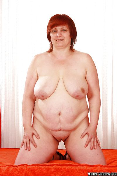 Fatty redhead granny with flabby boobs stripping off her clothes
