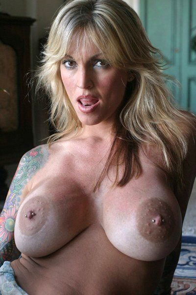 Breathtakingly sexy big titted milf Janine Lindemulder spreads her legs and touches her slit