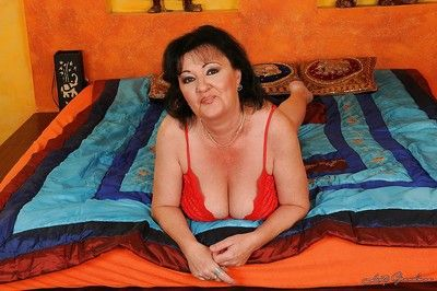 Buxom granny with big tits taking off her lingerie and spreading her legs