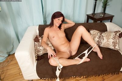 Older lady Sofia Matthews freeing tiny boobs and hairy pussy from lingerie
