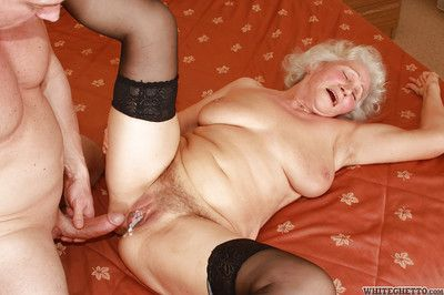 Lascivious granny in stockings gives a blowjob and gets banged hardcore
