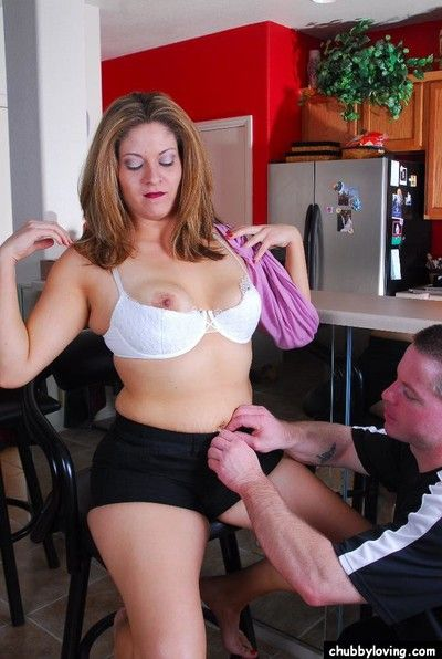 Chunky cougar Ryan being undressed for sex in kitchen by younger cock