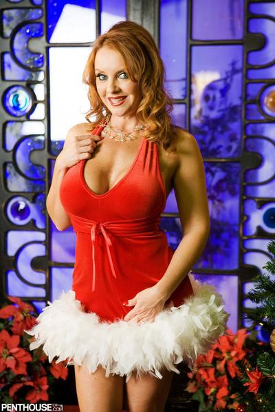 Hot and kinky posing from the bosomy milf in Christmas outfit Janet Mason