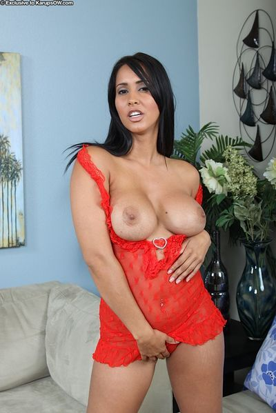 Busty black haired latina milf Isis Love dressed in red shows off her pussy