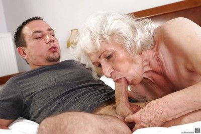 Grey haired granny Norma sucking off large cock to cumshot conclusion