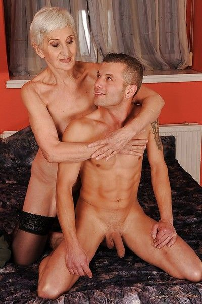 Short haired granny in stockings gives a blowjob and gets shagged