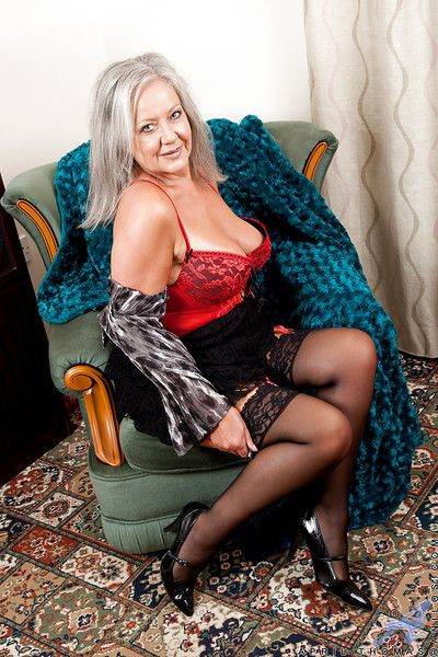 Chubby granny in stockings reveals her sexy lingerie and plays with herself