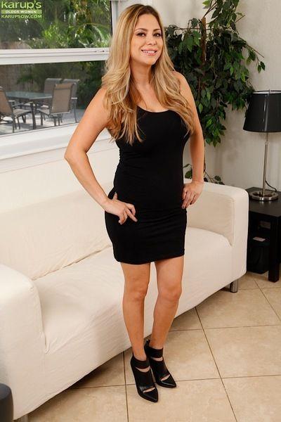Older Latina Gabriela Mendoza revealing huge boobs while undressing