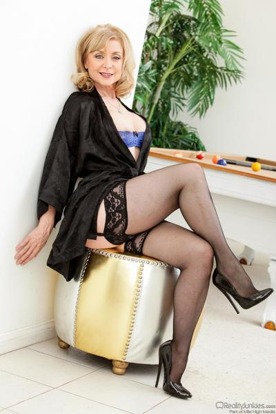 The big titted milf Nina Hartley is seducing the man with blue lingerie and stockings