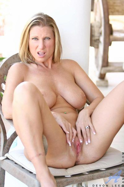 Shapely blonde with big round tits Devon Lee saddles her pussy on a thick dildo