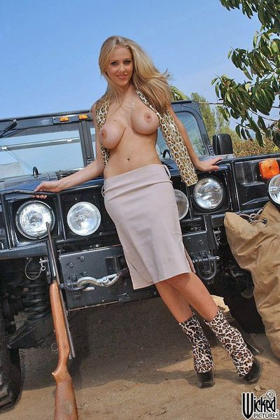 Blonde milf with big boobs Julia Ann is stretching legs in leopard boots on the car boot