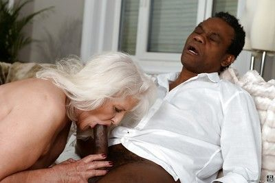 Overweight granny sucking off black cock for mouthful of sperm