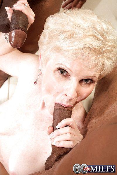 Lusty granny Jewel sucking off 2 black men at same time