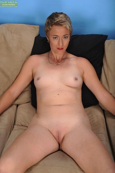 Short haired mature dame Liz Sophia sliding panties over nice ass and legs