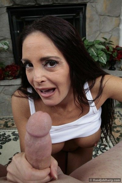 Slim big titted brunette milf Cheyenne Hunter strokes big cock with her hands
