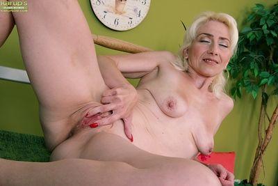 Skinny mature MILF Janotova spreading shaved granny pussy in close ups
