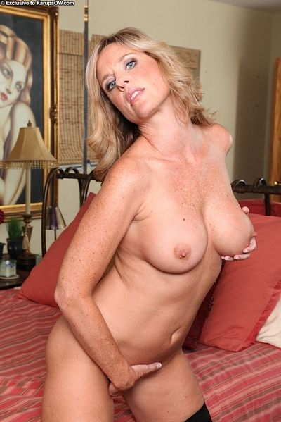 Mature blonde Jodi West showing off nice ass before masturbating in high heels