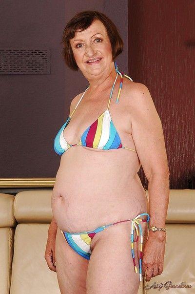 Fatty granny with tiny tits Eve Tickler taking off her bikini