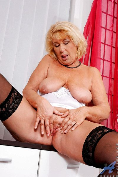Horny granny Regie is masturbating her pussy with her fingers