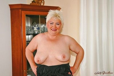 Short haired fatty granny with flabby boobs stripping off her clothes