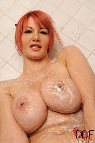 Red haired busty Lovely Vanessa wants to get off as soon as possible outdoor.