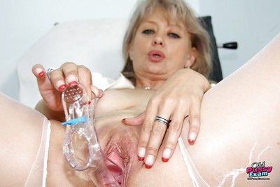 Naughty mature nurse masturbating her twat with various toys