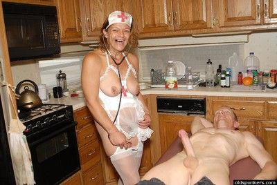 Aged nurse Ivee and her saggy tits giving a blowjob in the kitchen