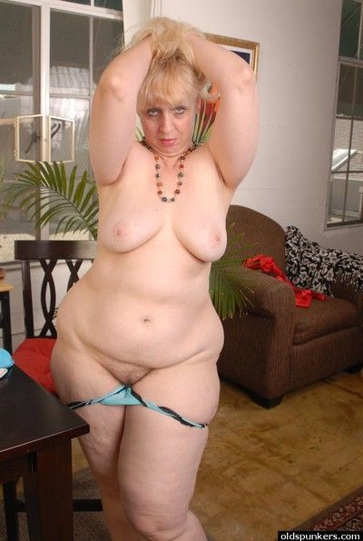 Awesome chubby blonde granny Anne drinking tea and fingering