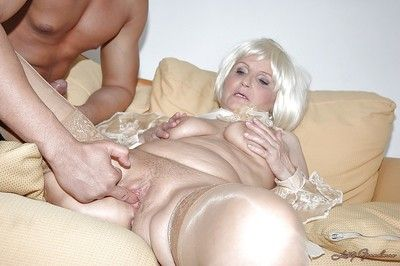 Slutty granny in stockings is into hardcore interracial fucking