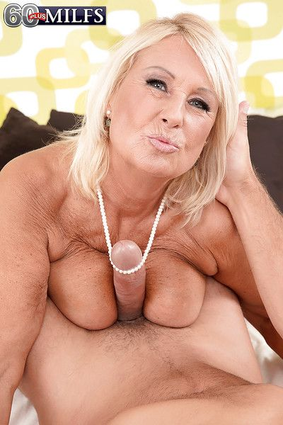Blonde Euro granny Regi displaying saggy tits while sucking off big dick