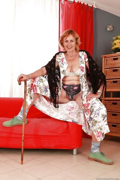 Lecherous granny stripping and teasing her unshaven twat