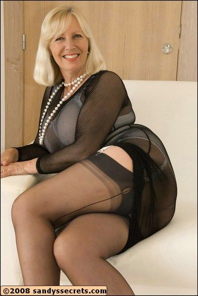 Busty old mom puts her tits on display by wearing sheer lingerie