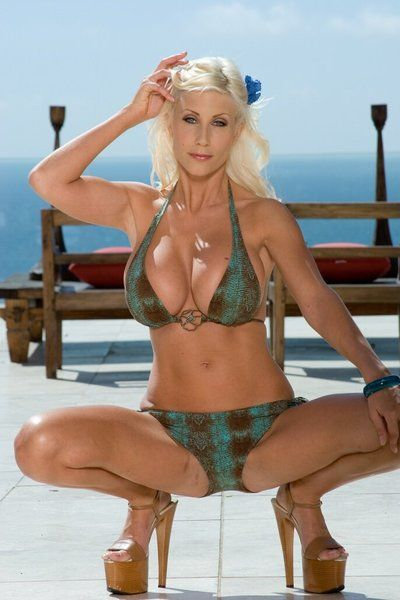 The lusty blonde milf Puma Swede is demonstrating huge melons and shaved nub outdoor