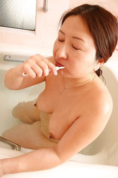 Chubby asian granny with saggy tits Miyoko Nagase taking bath