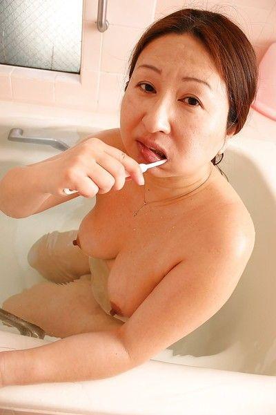 Chubby asian granny with saggy tits Miyoko Nagase taking bath