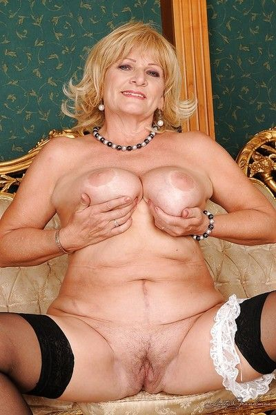 Curvy granny in stockings stripping off her suit and lingerie