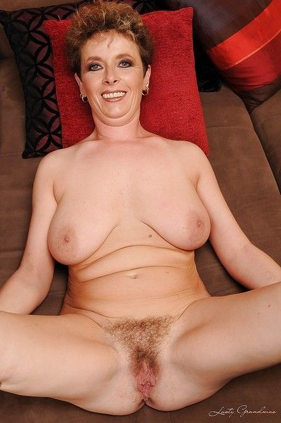 Lusty granny with big flabby jugs stripping and spreading her legs