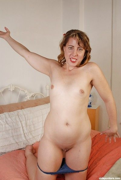 Sexy old woman is posing and masturbating her accurate red snatch