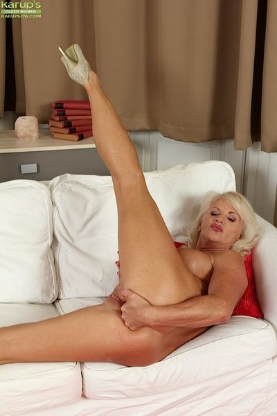 Naughty Granny Iris undresses her panties and poses in high heels