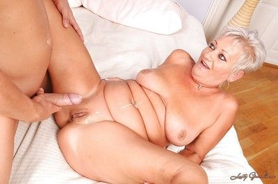 Naughty granny fucks a young dick and gets jizzed over her fatty belly