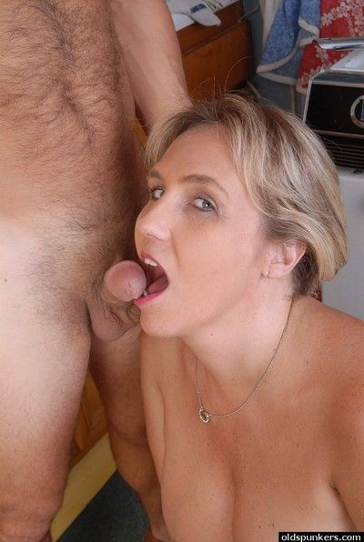 Mature blonde plumper Wanda tit smothering man in kitchen before oral sex