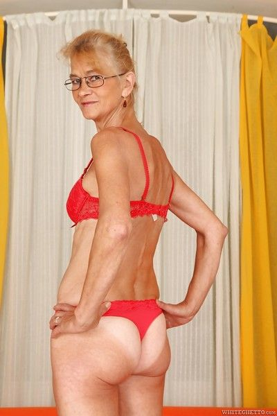 Lecherous granny with shaved twat stripping and spreading her legs