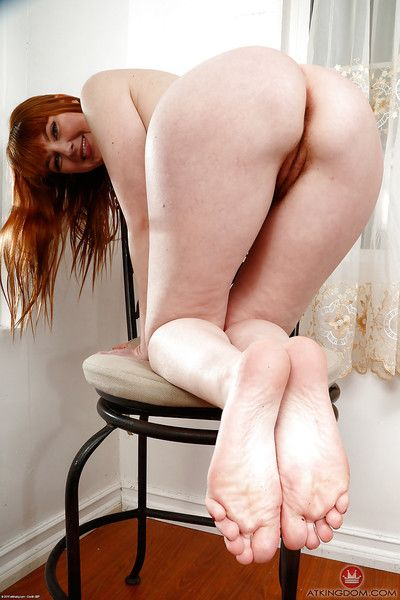 Older redhead Marie McCray slipping over hairy snatch and ass