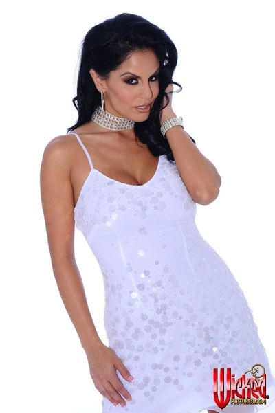 This is the luxurious brunette milf Mikayla that is posing in incredible dress