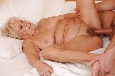 Busty granny gets her hairy twat nailed and takes a cumshot in her mouth
