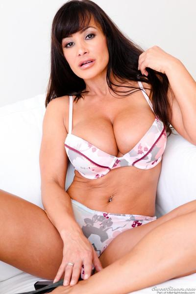 Lisa Ann is a horny busty pornstar who loves to show off her massive tits.